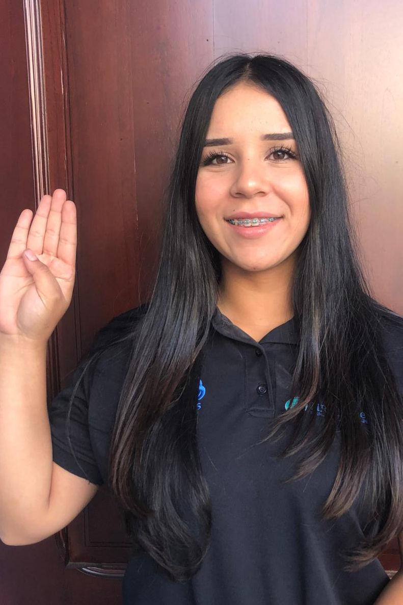 Katherine Ramírez Espinoza, wanted to demonstrate women can be mechanics, strikes the ChooseToChallenge pose.